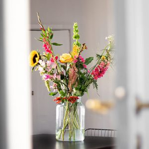 fresh flowers in glass vase of water